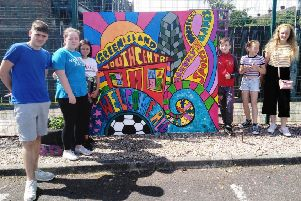 David Fee, Elizabeth Evans, Georgia Armstrong, Lewis Hunter, Kacey Brooks and Abigail Hillen at Greenisland Youth Centre's new mural.