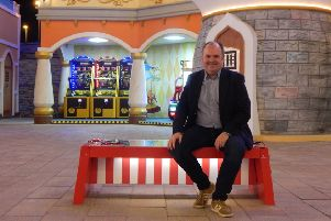 ESF Managing Director, Alan Lowry, with the themed Stellar Solar Smart Bench.