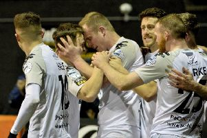 Jordan Owens (centre) celebrates his goal in Crusaders' victory over Carrick Rangers. Pic by INPHO.