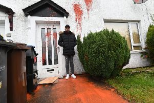Sergiu Preda inspects the damage caused to his home in Newtownabbey. Photo Colm Lenaghan/Pacemaker