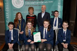Ballyclare Secondary School raised 5,584.06 and were Eastern Area runner up. ' Pictured are Faith Black, Ann Walker (Action MS), John Daly (patron), Ewan McLean, Paul Nixon, Emily Burke, Tazmin McConnell and Pearse Russell.