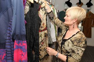 Yvonne Spence from Voni Blue with some of the clothes that are going to be used in the town's fashion show.