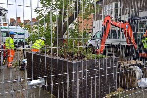 A trio of planters removed from St James Square have caused a bust up between a local residents' association and the county council. 2cchORrgv58Hr_qRO9G0