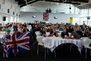 The audience watches the race at the Silverstone Wing