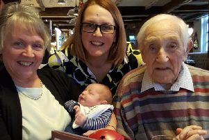 From the left, Walter's daughter, Anita Marston holding great-grandson, Mason. Above, granddaughter, Tina and right, Walter.