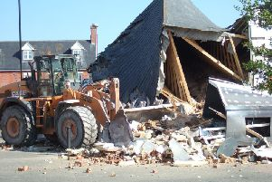The aftermath of the One Stop Shop ram-raid shows the roof almost entirely collapsed by the digger. Pictures by John Wright.