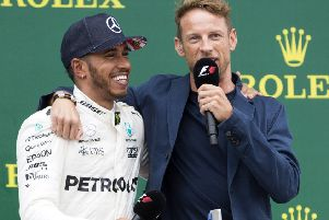 A smiling Lewis Hamilton celebrates his British Grand Prix success with Jenson Button at Silverstone (Pictures: Kirsty Edmonds)