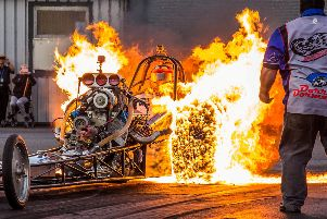 Dramatic image captures a 1,200bhp drag racing car being engulfed in flames as it performs a 'burn out' on the start line.  Photo: SWNS