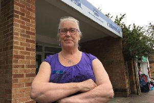 Volunteer Wendy Lavaast outside the RSPCA store in Main Road, Duston, which has been hit by another break-in.