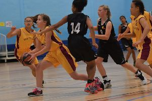 ON THE ATTACK - Ruby Harkins has here eyes on the basket during Northants Lightning Under-14s' clash with Leicester (Pictures: Dave Ikin)