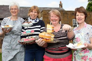 Taken in 2014, WI members Ann Cotton, Monique Shortt, Kate Earley and Heather Piper serving tea and cakes to the bluebell walkers in Badby