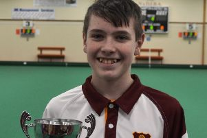 Northampton & District IBC's Thomas Manderson with his Northants Bowls Youth Development Scheme Junior Section title trophy