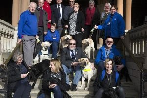 Councillor Christopher Malpas, centre, raised a record-breaking 61,000 for the Guide Dogs Association through his mayor's fund.