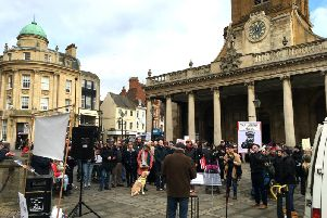 Around 80 people gathered outside All Saints Church on Saturday for the anti-cuts rally