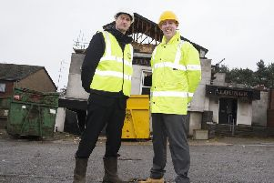 Chief executive of Northampton Partnership Homes (NPH) Mike Kay and project manager for the Tanners demolition William Jacobs pictured outside the decaying pub yesterday.