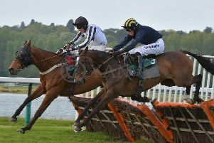 RIDDLESTOWN (far side) and jockey Jack Andrews are shown here  in winning form over hurdles at Towcester last May (Picture: David Yanez)