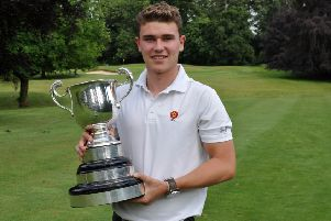 Liam McNeela pictured with the trophy after winning the County Men's Championship at Northampton GC