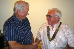 Outgoing Brackley Rotary Club president Ken Smith, handing over to new president Colin Gillies. NNL-180307-094933001