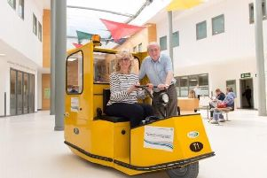Pictured volunteers at Peterborough Hospital on a replica buggy, which NGH is fundraising for. NGH would, however, like their buggy to be white and will brand it with the fundraisers names.