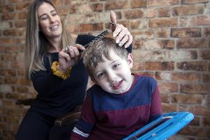 Charlie Browns Gentleman's Barbers is an autism-friendly barbers where little Alfie is pictured getting his haircut by Charlie.