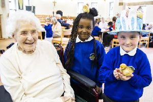 Edna, Amani and Pearse pictured today at St Christopher's Care Home with the chicks.