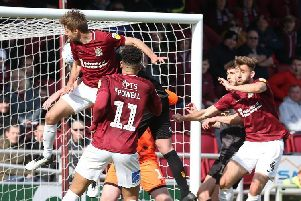 Sam Foley heads in another set-piece goal for the Cobblers. Picture: Pete Norton