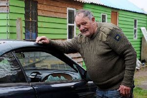 Bill Carpenter with the Ford Mustang which was vandalised during the burglary at his smallholding outside Brackley