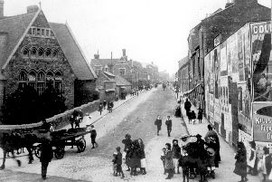 Men, women and children in the street next to John Clare School (now base for Northamptonshire Music & Performing Arts Trust) on Clare Street/Kettering Road junction