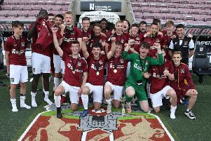 The Cobblers Football & Education A team celebrate their title success at the PTS Academy Stadium on Wednesday (Picture: Pete Norton)