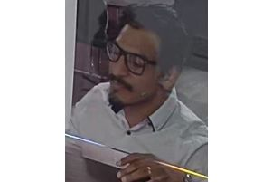 The face of a man police would like to speak to in connection with the theft of two cash cards. NNL-190523-133634005