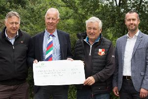 Wooden Spoon presents the 5,000 cheque to Fernie Fields Sports and Social Club