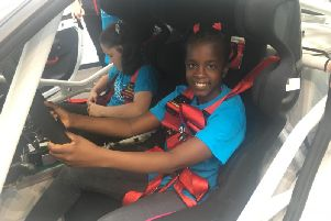 One of the Hunsbury Park Primary School pupils in a Porsche at the Dare To Be Different Event at Silverstone