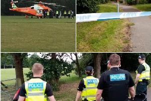 Police and the air ambulance at the playing fields where a man was attacked in Ecton Brook