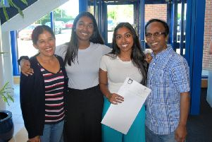 Leyna and her family celebrate as her exceptional grades confirm she is off to'Birmingham to study medicine