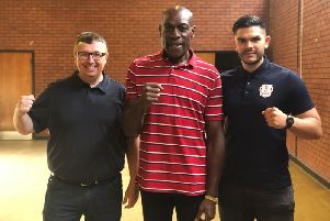 Frank Bruno (centre) celebrates getting the space to open a mental health referral centre and boxing club in Standens Barn Community Centre in Northampton with Cllr Brandon Eldred (left) and Alex Le Guvel from England Boxing. Photo: Frank Bruno/Twitter