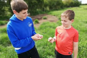 MowMow Rocks co-founder Matt Faulker's sons Harry, 13, and Oliver, 10, with their rocks. Photo: MowMow Rocks