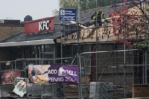Building work has begun once again at Taco Bell with signs saying it is 'opening soon'