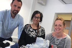 Pictured from left to right is UON colleagues Paul Tucker and Tania Salam with Hope Centre fundraising and marketing manager, Louise Danielczuk.