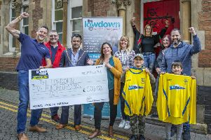 Stan Robertson, the mayor of Northampton, members of the Lowdown team and sponsors handed over the giant cheque in the town centre on Saturday.