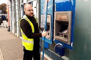 A contractor pulls the cladding off an ATM outside of Nationwide in Weedon Road.