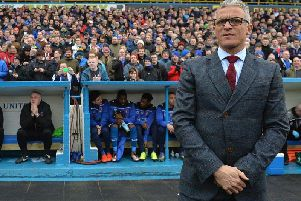 Keith Curle stands in front of the Brunton Park Paddock
