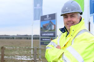 John Dillon at the new DWH Overstone site cutting the sod