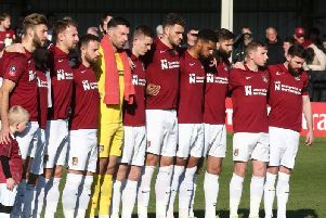 Cobblers pause for a moment of silence on Remembrance Sunday. Pictures: Pete Norton
