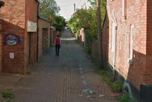 A six-foot red brick wall in a Northampton neighbourhood collapsed outwards into an alleyway.