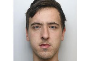 Christopher Hulland is wanted by police