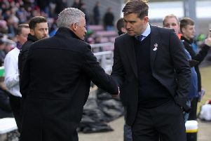 Michael Jolley and Keith Curle shake hands before last season's 2-2 draw between Northampton and Grimsby