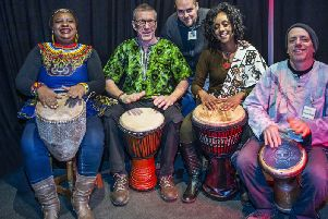 (L-R) Mavis Mundirwa, Richard Dobson, Pedro Duarte, Anne Wankiiri and Mike McArthur have a go at African drumming at the African and Caribbean Festival