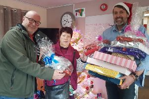 Welford House manager Mark, Jeanette and Adrian Smith from Smith's Farm handing over the presents