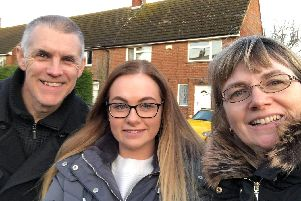 (L-R) Andy, Phoebe and Karen Johnson outside their home in Roade which has been in their family for 70 years