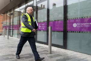 Mark Morrell outside Northamptonshire County Council's offices after serving a notice for the local authority to fix potholes in 2018